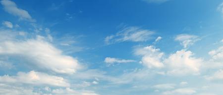 Light cumulus clouds in the blue sky. Wide photo. Stock Photo