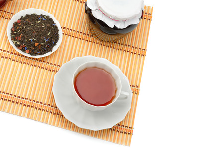 Cup of tea, jam jar and tea leaves isolated on white background. Flat lay, top view. Free space for text. 版權商用圖片