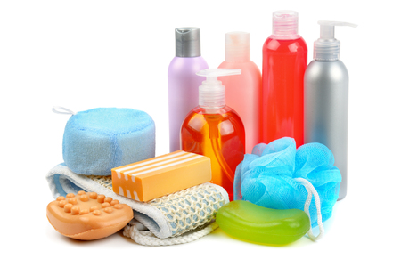 Shampoo, soap and bath sponge isolated on white background. Assortment of personal hygiene items.