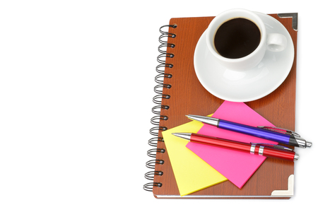Notebook and cup of coffee isolated on white background. Flat lay, top view. Free space for text. Banque d'images
