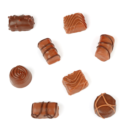 Assortment of chocolate candies isolated on white background. Flat lay, top view. Banque d'images