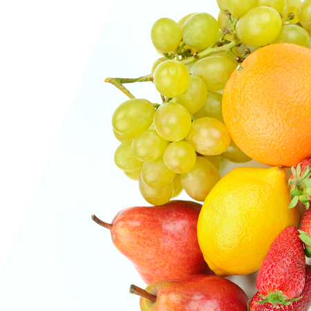 Fruit and berries isolated on white background. Healthy food. Free space for text.