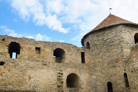Fortress tower with tiled roof on blue sky background. Location place Ukraine, Europe. Explore the world's beauty.