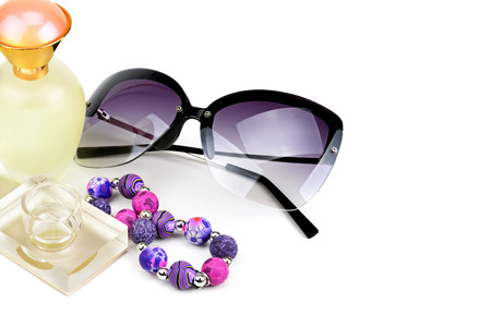 bottles, sunglasses and bracelet isolated on white background. Fashionable women's accessories. Free space for text.