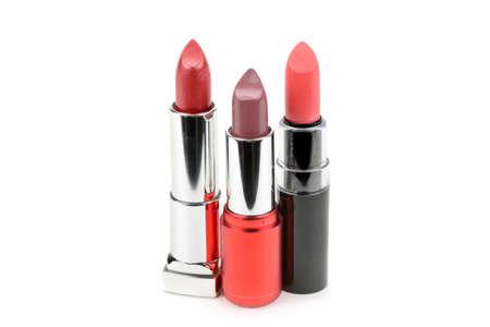 Set of lipsticks isolated on white background.