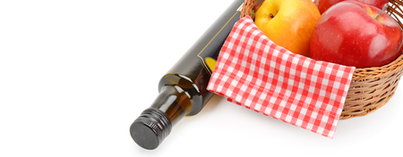 Apple cider vinegar in a bottle and ripe apples isolated on white background. Free space for text. Wide photo. Archivio Fotografico