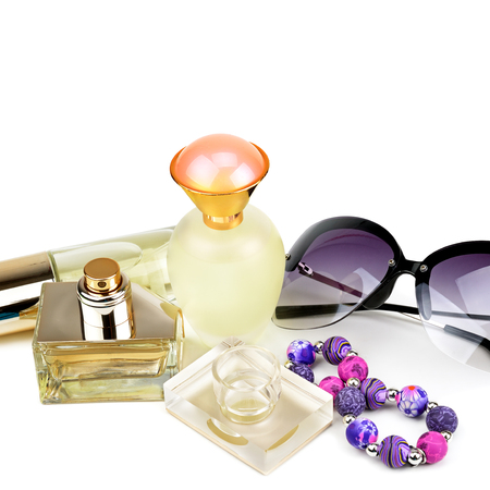 Perfume bottles, sunglasses and bracelet isolated on white
