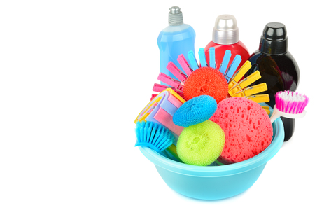 Set of household chemicals, sponges, napkins for cleaning isolated on white background. Free space for text.