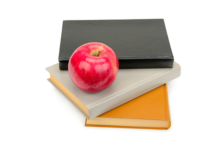 Books and red apple isolated on white Zdjęcie Seryjne