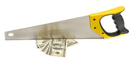 Hand sawing a bundle of US dollars. Metaphor. Economic Concept. Stock Photo