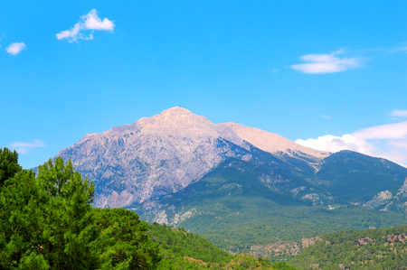 The top of the mountain Olympos (Turkey) against the blue sky. Picturesque and gorgeous scene.