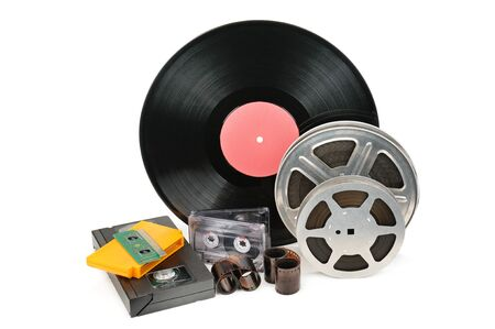 Vinyl record, video and audio cassettes isolated on white