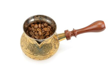 Coffeepot and coffee beans isolated on white background.