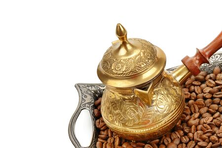Coffeepot and coffee beans isolated on white background. Free space for text.
