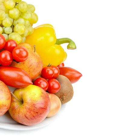 A set of fruits and vegetables on a platter isolated on white background. Free space for text.