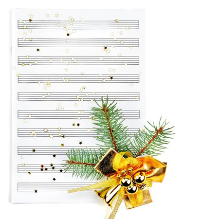 Christmas decorations and music sheet isolated on white background. Free space for text.