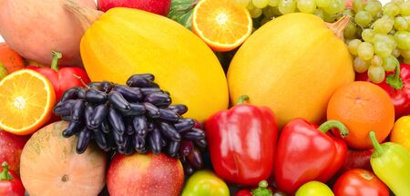 Bright background from the collection of fruits and vegetables. Wide photo.