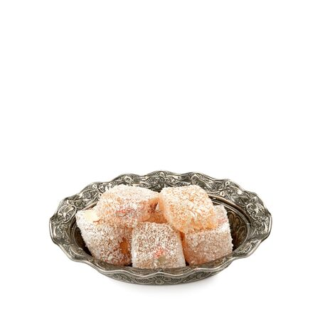 Turkish Delight on a vase isolated on white background. Free space for text.