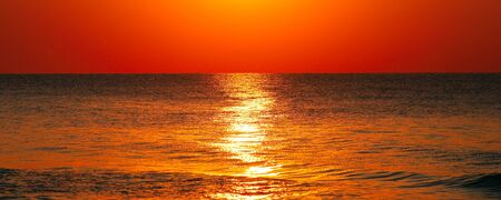 Beach of the ocean and beautiful sunrise. The concept is travel. Wide photo.