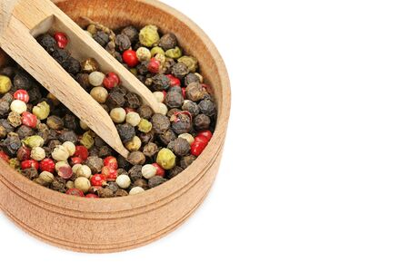 A mixture of allspice in a wooden cup isolated on white background. Free space for text. 스톡 콘텐츠