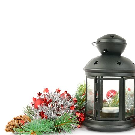 Composition of the Christmas decorations . Bright ornaments, hand lantern and spruce branches isolated on white