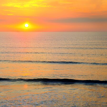 Beach of the ocean and beautiful sunrise. The concept is travel. 스톡 콘텐츠