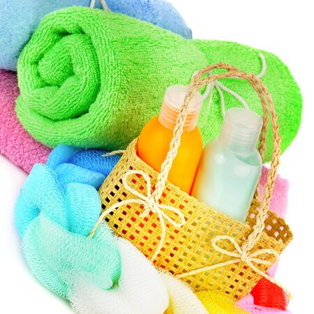 Cotton towels, cosmetic soap, sponge and shampoo isolated on white background.