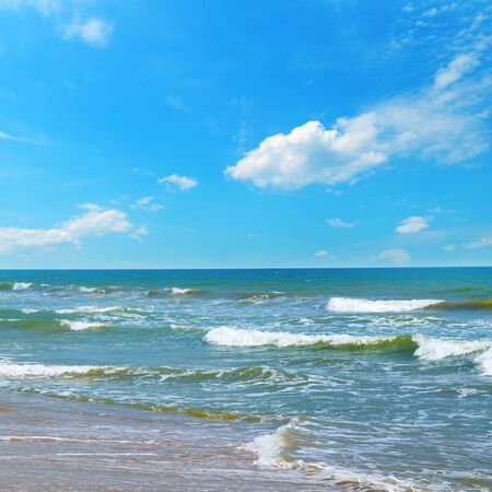 Beautiful seascape and blue sky. Sand beach. The concept is travel. 스톡 콘텐츠