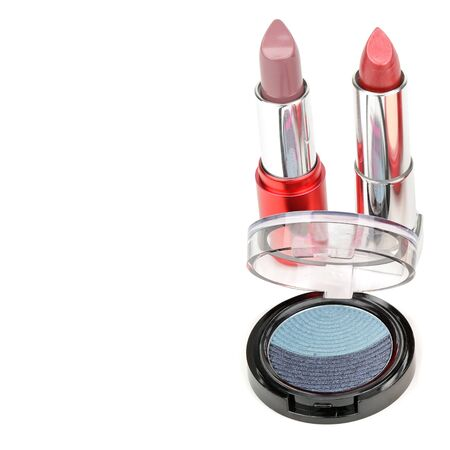 Set of lipstick and eye shadow isolated on white background. There is free space for your text.