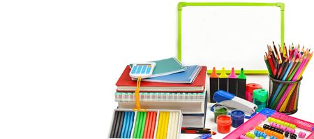 A set of school and office supplies isolated on a white background. Free space for text. Wide photo.