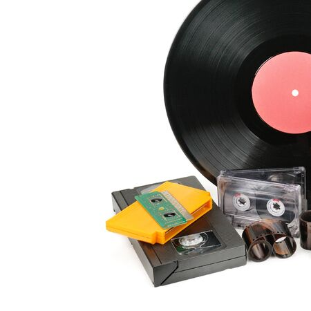 Vinyl record, video and audio cassettes isolated on white background. Retro equipment. Free space for text.