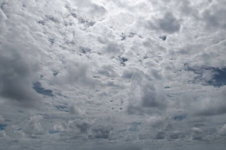 Sky with gray cumulus clouds. Dramatic cloud cover.