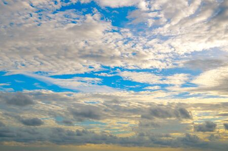 Cumulus and cirrus clouds on a blue sky. Stock Photo