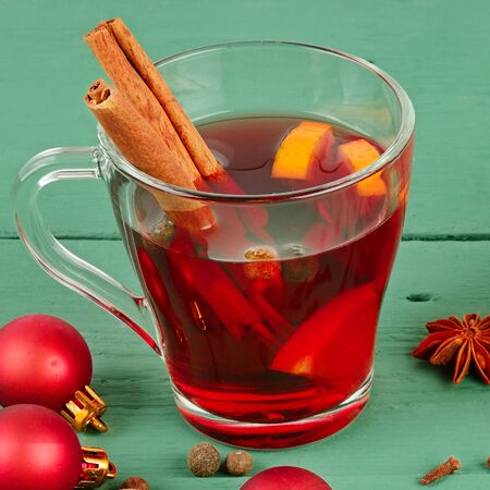 Mulled wine. Hot red wine drink with sugar and spices.