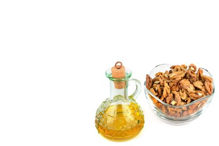 Cosmetic and therapeutic walnut oil isolated on white background. Free space for text. Zdjęcie Seryjne