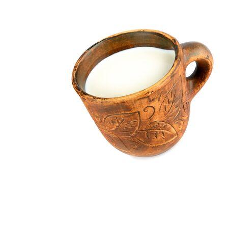 Ceramic mug of fresh milk Isolated on white background. Free space for text.