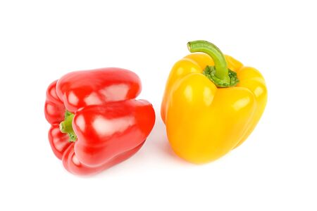 Red and yellow peppers isolated on a white background.