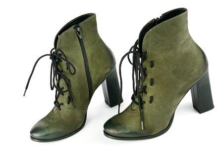 Ankle boots isolated on white background. City lifestyle. Female fashion.