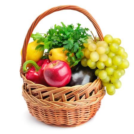 Vegetables and fruits in a basket isolated on white