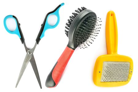 Scissors and stools for grooming dogs and cats. Items are isolated on a white background. Standard-Bild