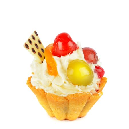 Small cake with cream and fruit isolated on a white background.