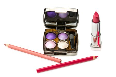 Set of lipstick and eye shadow isolated on white background. Standard-Bild