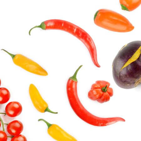 Cherry tomatoes, chili pepper and kohlrabi isolated on a white background. Colorful background. View from above. Standard-Bild