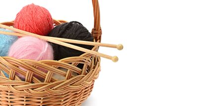 Set of wool balls in a basket isolated on a white background. Free space for text. Wide photo . Standard-Bild