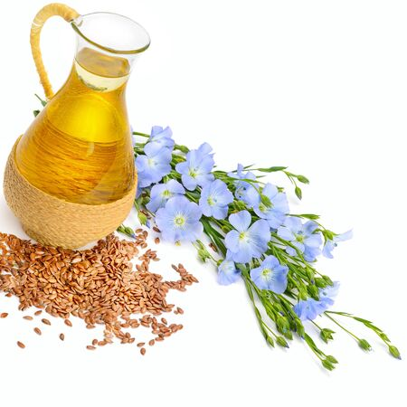 Linseed oil, flax seed and flowers isolated on a white