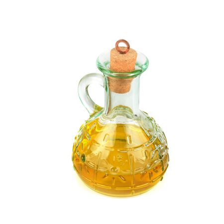 Decanter with farm organic vegetable oil, isolated on white background.
