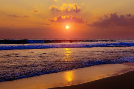 Beautiful tropical sunset on the beach . The concept is travel.