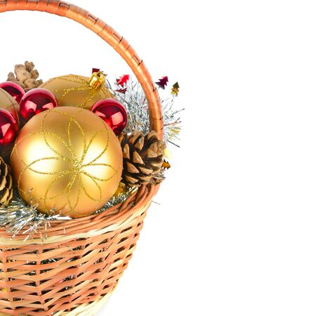 Christmas decorations and pine cones in a wicker basket isolated on white background. Free space for text.