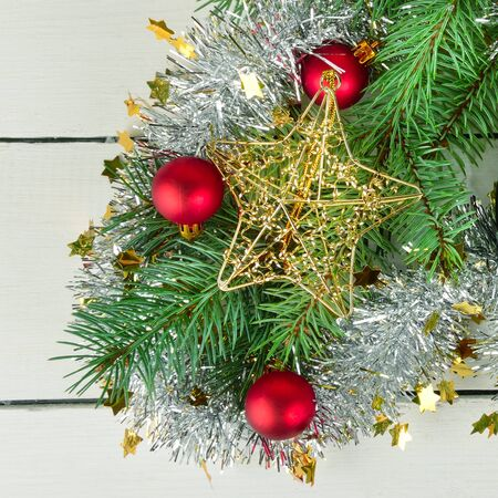 Beautiful christmas background. Branches of spruce and Christmas decorations on a white background.