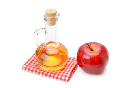 Apple cider vinegar in a glass vessel isolated on white